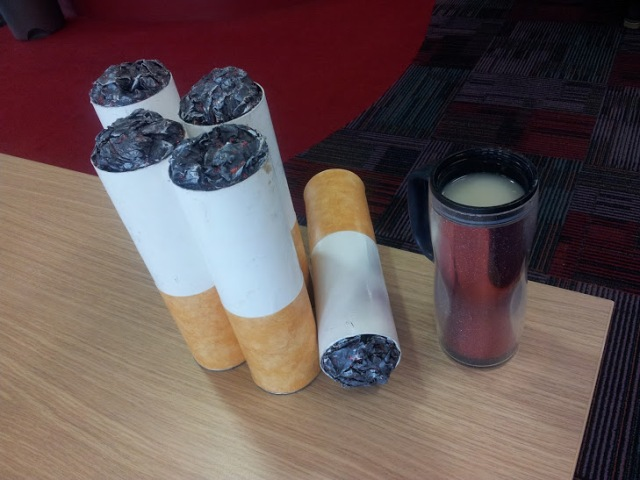 Coffee and cigarettes. Just say no! These giant cigarettes were made from Pringle tubes by social marketing colleagues to support the No Smoking Day activities.