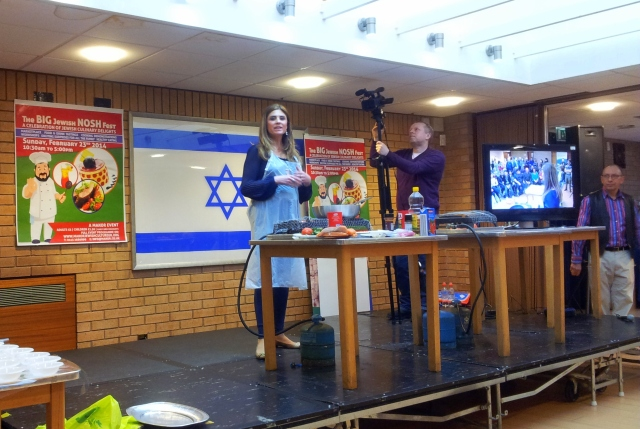 Ellie Ruhan prepares a quick and easy sephardi fish dish at the Big Jewish Nosh Fest. Howard Lee is far right.