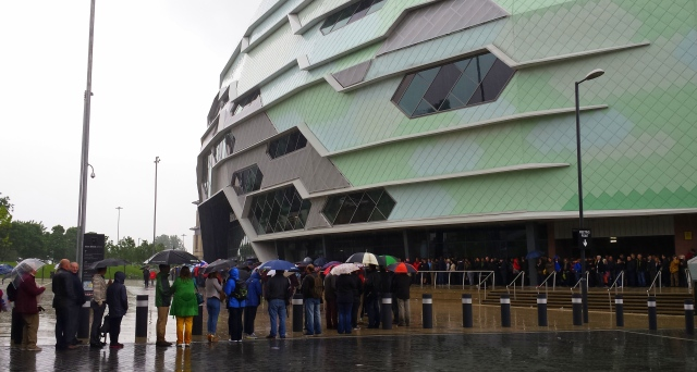 Le grand Depart tourmakers queuing in the rain at the First Direct Leeds Arena.