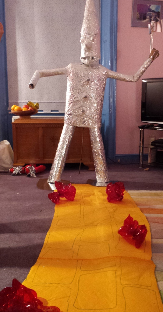 Tin Man, yellow brick road, poppies and a crushed witch