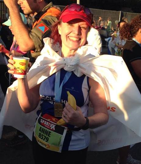 Medal, cape, banana, cup of soup, the Lausanne Half Marathon done and dusted