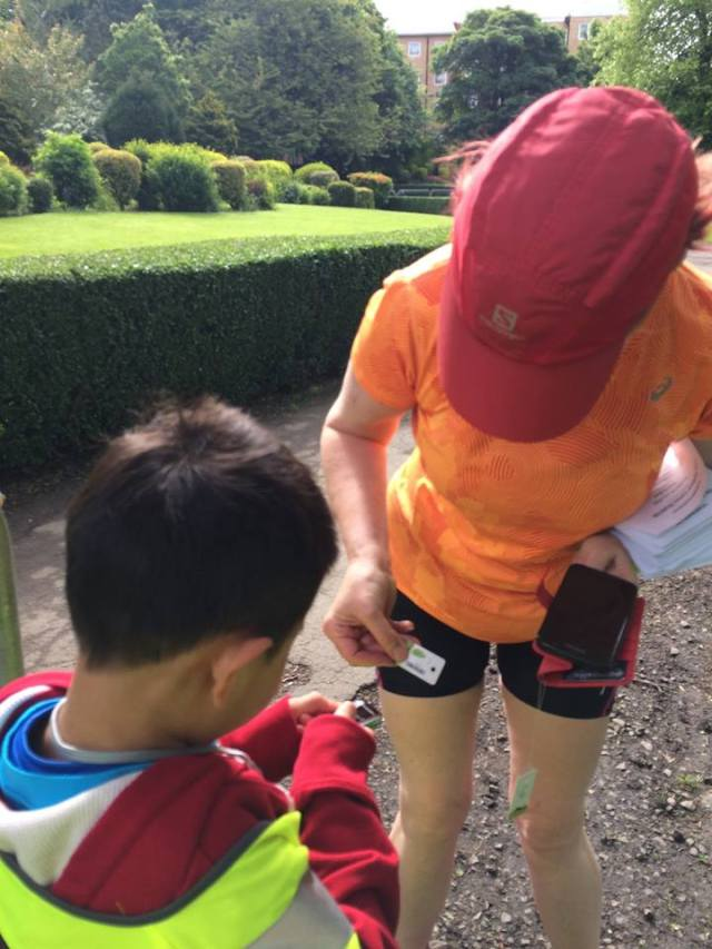 Shang-Chen, one of my youngest parkrun friends, scans my barcode